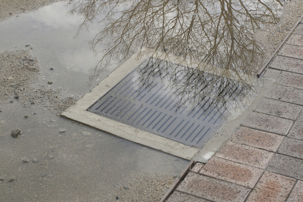 Sidewalks clogged drain